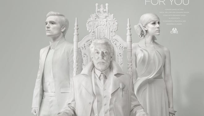 "Peeta  (Josh Hutcherson) and Johanna (Jena Malone) flank President Snow in the president's official portrait for ""The Hunger Games: Mockingjay - Part 1."""