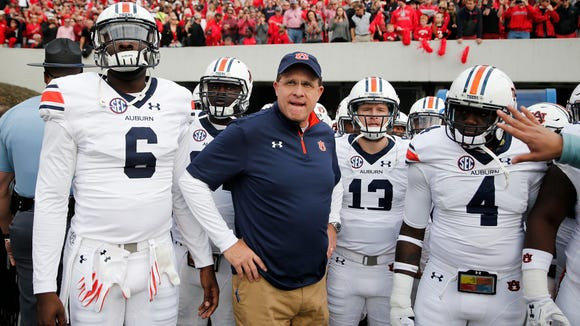 Jeremy Johnson stands side by side with Auburn head