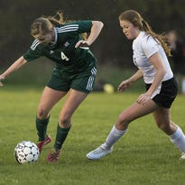 D.C. Everest's Kelly Bodette, left, goes against SPASH's Brooklyn Seefeldt during a Wisconsin Valley Conference soccer game at the Portage County Youth Soccer Complex, Tuesday, May 3, 2016.