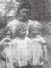 Mama's girls: Joan, Jane and Judy Grant, age 3, with their mother, Ruby Grant.