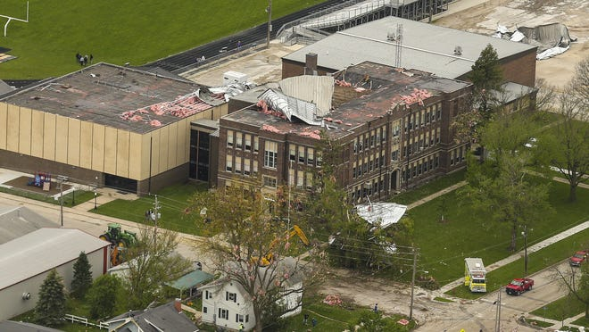 The damage to South Central Calhoun High School is seen a day after Sunday's tornado hit Lake City.
