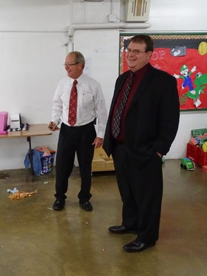 Terry Conard, director of Friendly House, took state Sen. Larry Obhof on a tour of Friendly House on Monday. AT&T gave Friendly House $7,000 for its 912 Program.