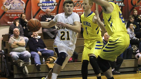 Elco senior Caleb Buchmoyer drives to the basket during the Raiders' 72-52 win Thursday over Northern Lebanon on Senior Night.