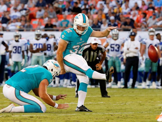 John Potter of the Miami Dolphins #32 kicks a first