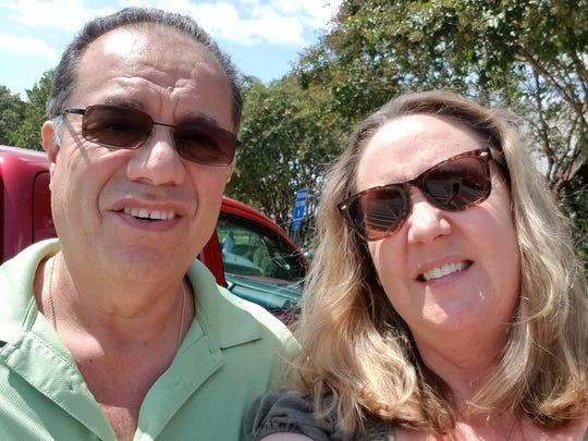 John and Chantal Escoto stop for a selfie after crossing