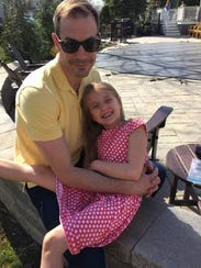 Lily Ramsperger, age 6, with her dad, Marc.