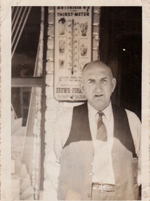 Shoeless Joe Jackson stands in front of his liquor store in West Greenville, sometime in the mid 1940s.