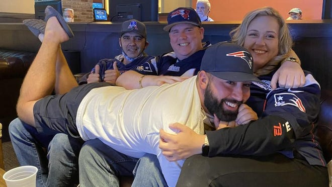 Front, Jonathan Rennick, of Peabody, Mass., and friends, from left, Shawn Harnish and Kenny Alder of Salem, Mass., and Michelle Varga of Merrimack enjoyed their time at The Brook watching Sunday's Week 1 NFL games.