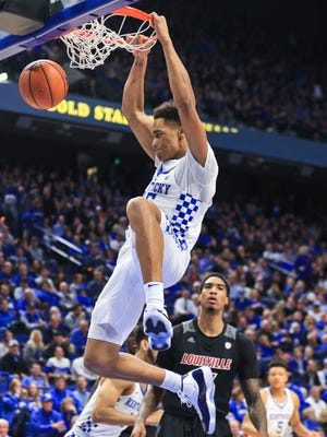 Kentucky's PJ Washington slams down two of his 16 points in the Wildcats throttling of Louisville 90-61 Dec. 29 in Rupp Arena.