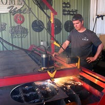 Local businessman harnesses thunderbolts to create metal designs