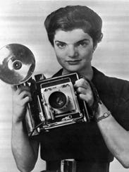Jacqueline Bouvier holds her camera in 1953 when she