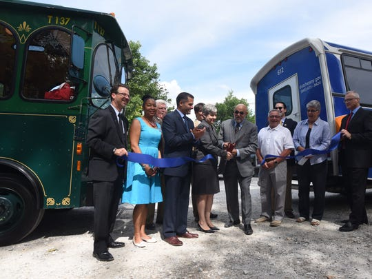 Various community leaders assemble to announce a weekend trolley line running between Cold Spring and Beacon. From left to right: Rich Kleban, senior vice president and C.O.O., Dutchess County Regional Chamber of Commerce; April Farley, Dutchess County legislator; Marc Molinaro, Dutchess County Executive; Cynthia Ruiz, Dutchess County transportation administrator; Vincent M. Tamanga, Chairman of Putnam County's transportation task force; Randy Casale, mayor of Beacon; Mary Kay Vrba, president and C.E.O., Dutchess Tourism, Inc.; and Anthony Ruggiero, Beacon city administrator.