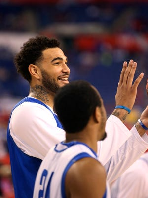 Kentucky's Willie Cauley-Stein and E.J. Floreal share a laugh during practice.   April 3, 2015
