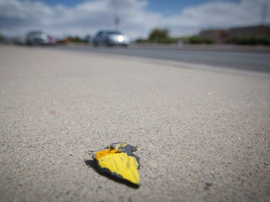 A piece of yellow plastic debris, seen on March 30, 2016, one of dozens spread out over 50 feet of University Avenue, at the site of a fatal motorcycle crash from the night before. The man killed in the crash, Matthew Lee Richter, was driving a yellow 2004 Suzuki motorcycle.