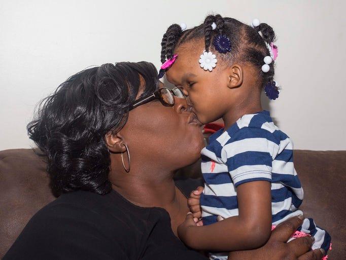 Tishana Alford kisses her daughter, Zoe Grace Alford.