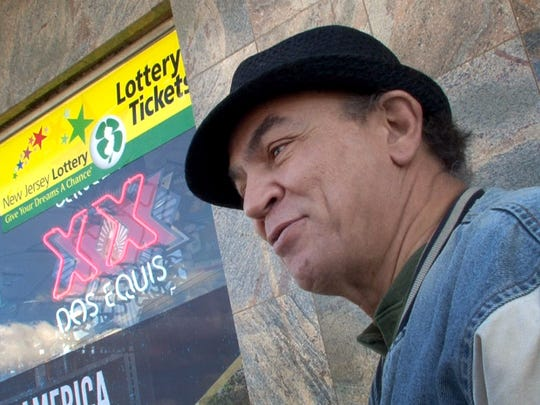 Lottery player Harry Daguiar, Lakehurst, is interviewed outside the Bailey's Discount Liquors in Lakehurst on Friday.