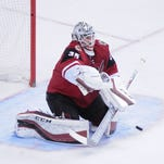Dec. 17, 2015; Glendale; Arizona Coyotes goalie Louis Domingue (35) makes a save during the third period against the Columbus Blue Jackets at Gila River Arena.