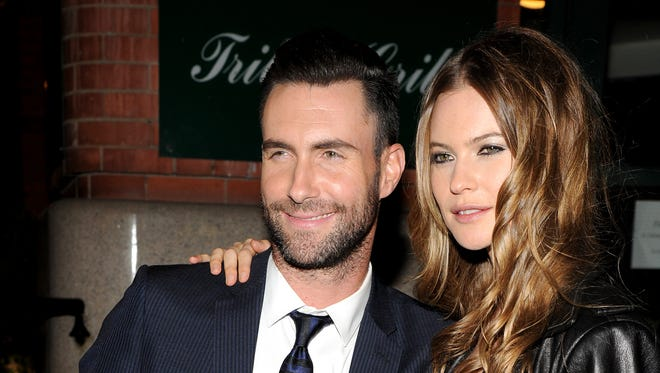 Adam Levine (L) and model Behati Prinsloo attend the CHANEL Dinner in honor of the 2014 Tribeca Film Festival closing night film 'Begin Again' at Tribeca Grill on April 26.