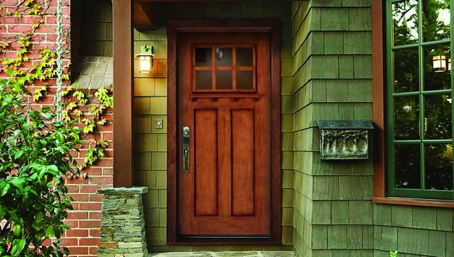 Today's energy-efficient door, such as this JELD-WEN Aurora fiberglass door shown in Mahogany Antique Cashmere finish, can look as good as it performs.