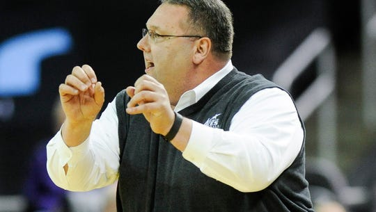 Evansville head coach Marty Simmons yells down court