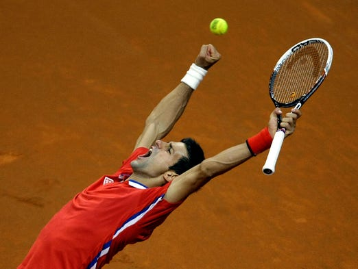 Novak Djokovic pulled Serbia even with Canada with a straight-sets victory against Milos Raonic in Belgrade, Serbia, on Sunday.