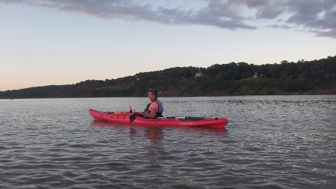 Gail Porter, owner of I Paddle New York, paddles her kayak in the Hudson River. Porter was introduced to kayaking about 10 years ago and now takes others out from Lynch's Marina and the Saugerties Beach, both in Saugerties.