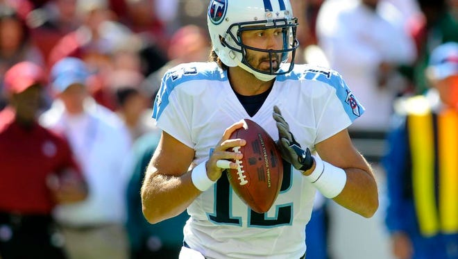 Titans quarterback Charlie Whitehurst looks to pass during the first half against the Redskins.