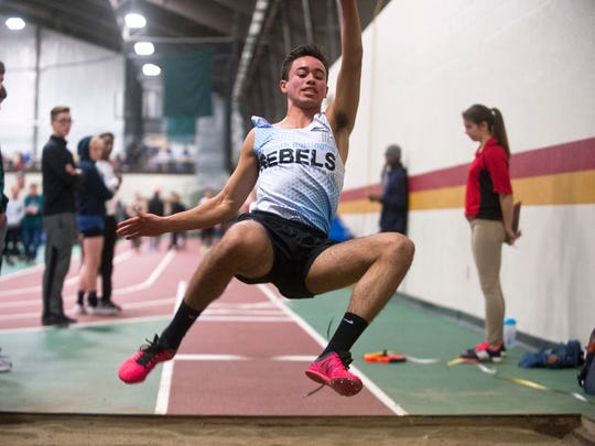 South Burlington's Ben Moran takes off in the Division I boys long jump during the Vermont indoor track state championships on Saturday at Norwich University.