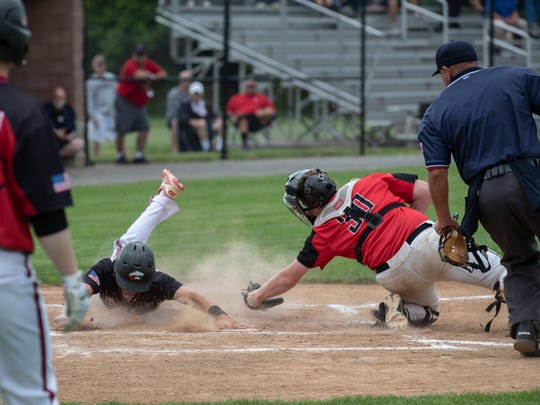 Jackson Memorial's Alex Iadisernia slides in safely into home in the first inning for Jackson only score of game. Hunterdon Central defeats Jackson Memorial 3-1 in NJSIAA Group IV semifinal baseball game at Rider University in Lawrenceville, NJ on June 5, 2018.