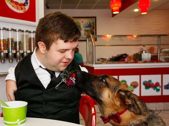 'Troy' sniffs on owner Nick Ackerman's corsage while
