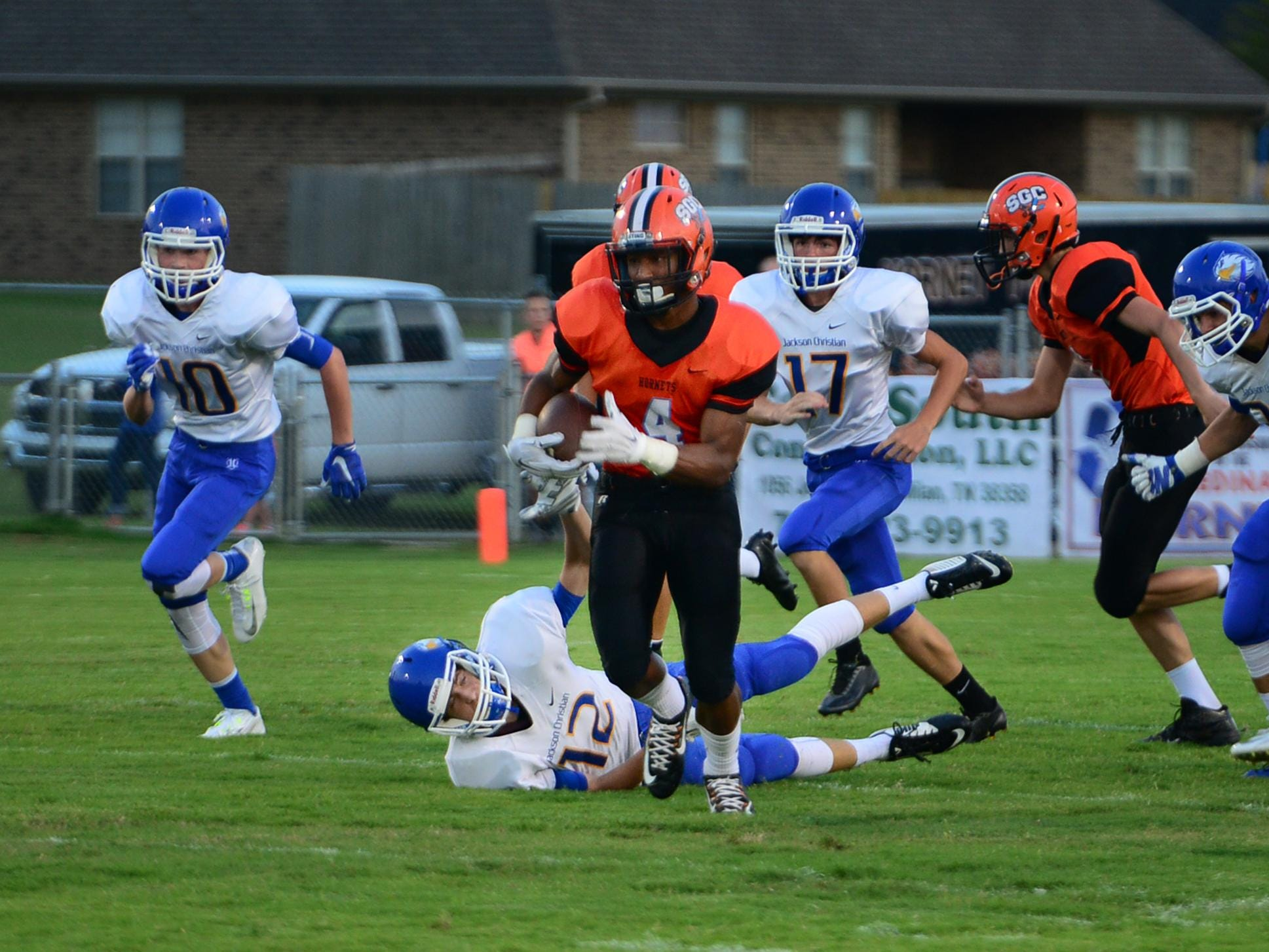South Gibson County's Tyler Dysart returns the opening kickoff for a touchdown during their game Friday against Jackson Christian.