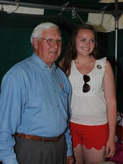 Red Wing great Alex Delvecchio poses with Maura MacDonald