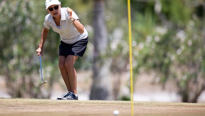 Angela Willard wills her putt to the hole on the 17th hole at the Naples Beach Hotel & Golf Club in April 10 in Naples.