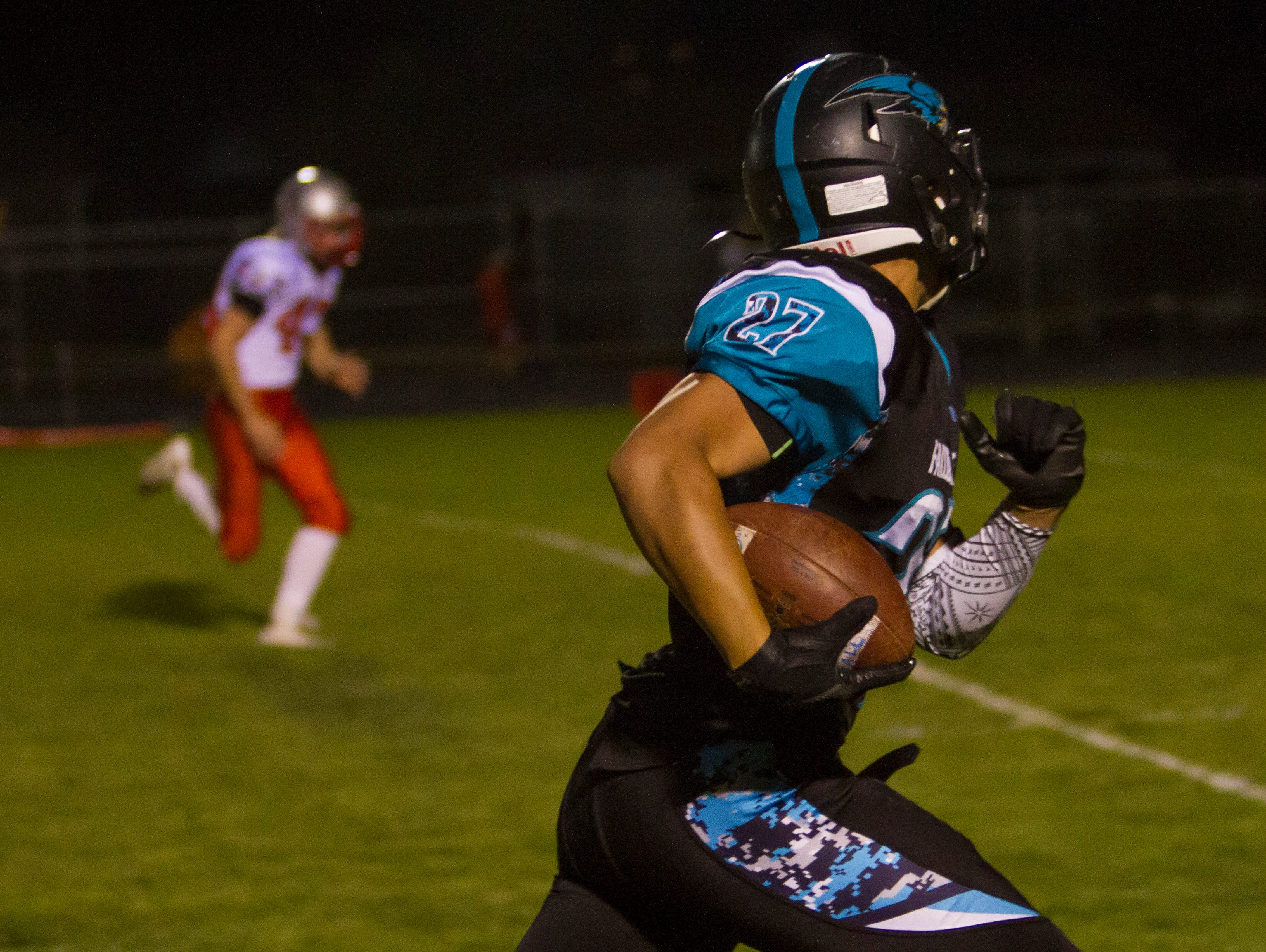 Canyon View's Jackson Vasi (#27) catches a pass for a first down against Manti, Friday, Sept. 18, 2015.