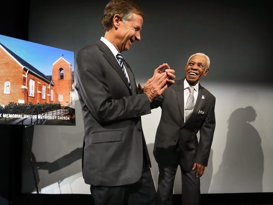 Gov. Bill Haslam (left) jokes with 86-year-old Elmore Nickleberry, one of the few city sanitation strikers who still works for the city, after a ceremony at the National Civil Rights Museum to announce the 10 Tennessee historic sites on the new, multi-state U.S. Civil Rights Trail.