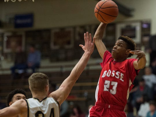 Bosse's Jaylen Minor (23) dunks over Boonville's Blake Rinehart (34) during the Class 3A Boonville Sectional at Boonville High School on Tuesday, Feb. 27, 2018. Bosse defeated Boonville 92-62.