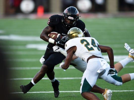 Catholic players take down Maryville's Isaiah Cobb