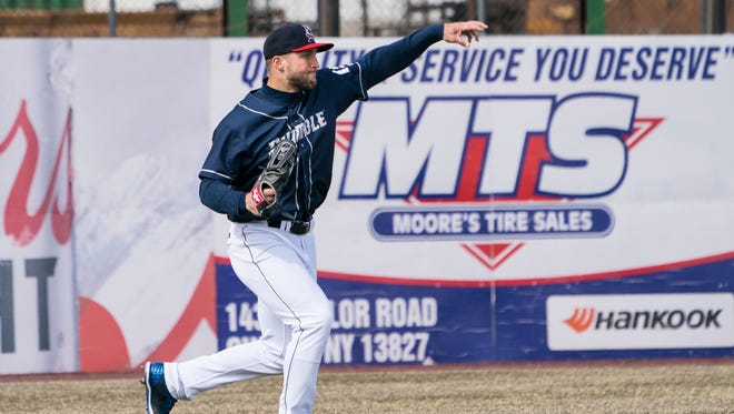 Apr 7, 2018; Binghamton, NY, USA; Binghamton Rumble Ponies left fielder Tim Tebow (15) throws the ball during the fourth inning of the game against the Portland Sea Dogs at NYSEG Stadium.