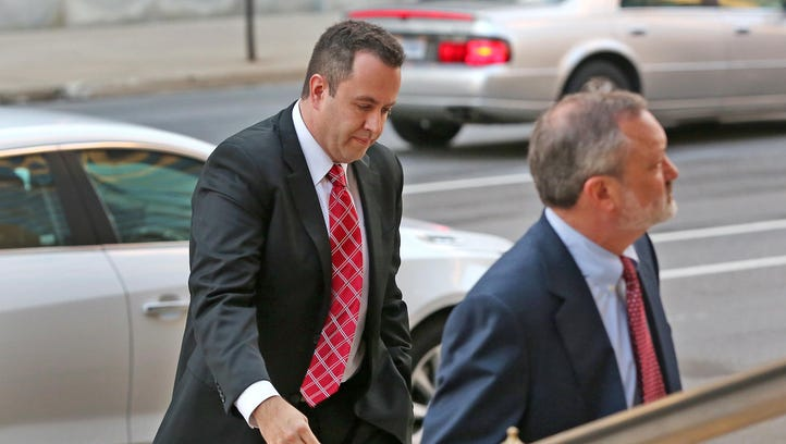 Jared Fogle, left, enters the Birch Bayh Federal Building and United States Courthouse for sentencing Thursday, Nov. 19, 2015. Fogle has been transferred to a prison in Colorado.
