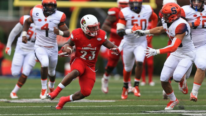 Louisville's Brandon Radcliff made a big run in the second half as the Cards rolled past Syracuse 41-17 Saturday.