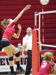 Rossview's Jessica Mattson spikes the ball for a kill