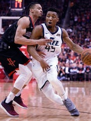 Utah Jazz guard Donovan Mitchell, right, dribbles as Houston Rockets guard Gerald Green defends on May 8, 2018.