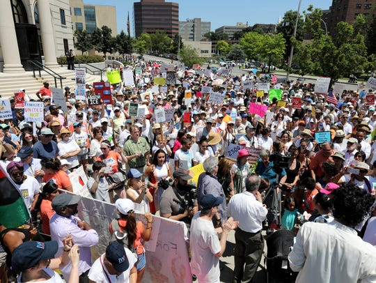 "A huge crowd fills the plaza during the ""Families Belong"