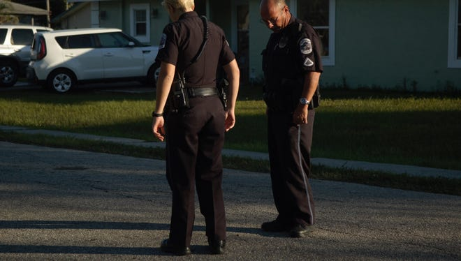 FMPD officers at Davis Street and Lincoln Boulevard look for bullet casings after a report of shots fired in the area