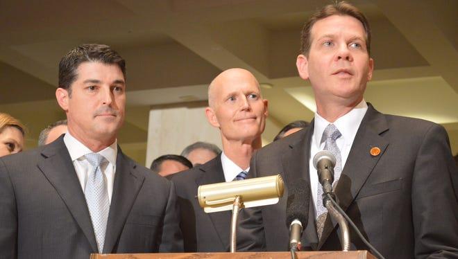 House Speaker Steve Crisafulli, R-Merritt Island, and Gov. Rick Scott listen as Senate President Andy Gardiner, R-Orlando, speaks after adjournment of the legislative session.