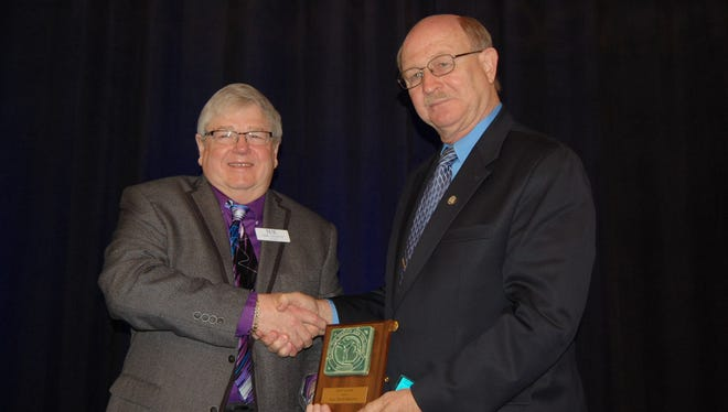 Rep. Dave Maturen, right, receives an award from the Michigan Association of Counties.