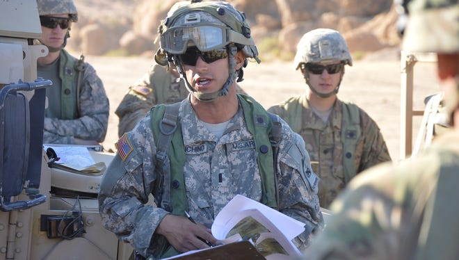 First Lt. Vincent Franchino of Delta Company, 1-501st, delivers a tactical convoy briefing while at NTC.