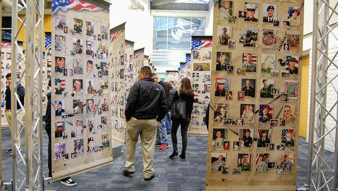 "Close to 80 people gathered at Hartnell College's Student Center on Tuesday for the opening of the ""Remembering Our Fallen"" memorial, a traveling photographic display honoring nearly 5,000 soldiers who died in the global war on terrorism since Sept. 11, 2001."