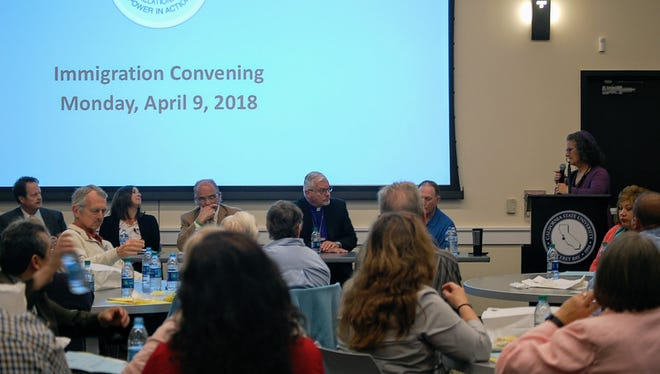 Panelists listen to a question from Rabbi Paula Marcus during Monday's COPA immigration discussion.