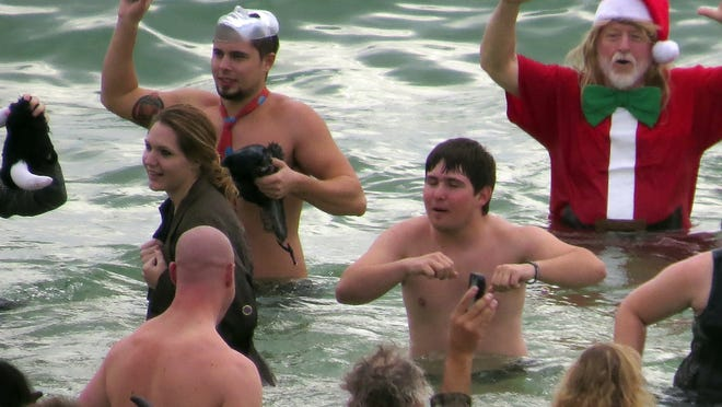 Hundreds of people came out last year to participate in the Flora-Bama Polar Bear Dip ... or at least photograph friends and family participating in the event behind the Flora-Bama Lounge on Perdido Key.